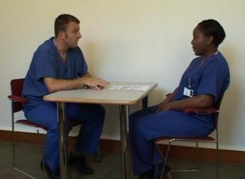 Trainee and supervisor conversing