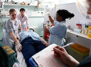 Medical team carrying out medical treatment on a patient