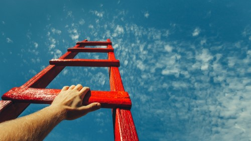 Image of person climbing a ladder