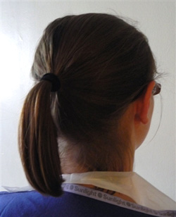 Image showing doctor with hair tied back.