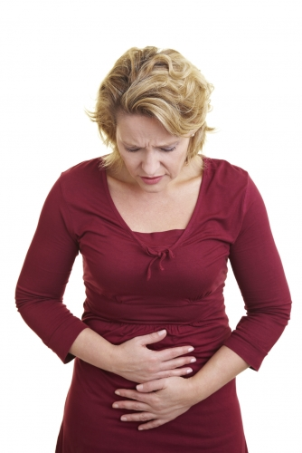 Woman experiencing pelvic pain, clutching her pelvic area