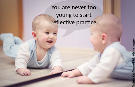 Baby looking in mirror saying you are never too young to start reflective practice