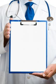 Doctor with stethoscope holding a clipboard