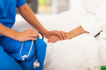Image showing doctor holding patient's hand