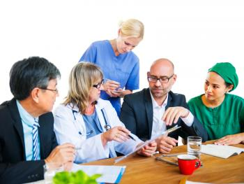 Image of several doctors sitting around a table