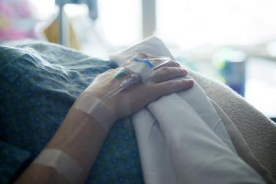 woman with IV in hand