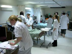 Hospital staff in white coats on ward